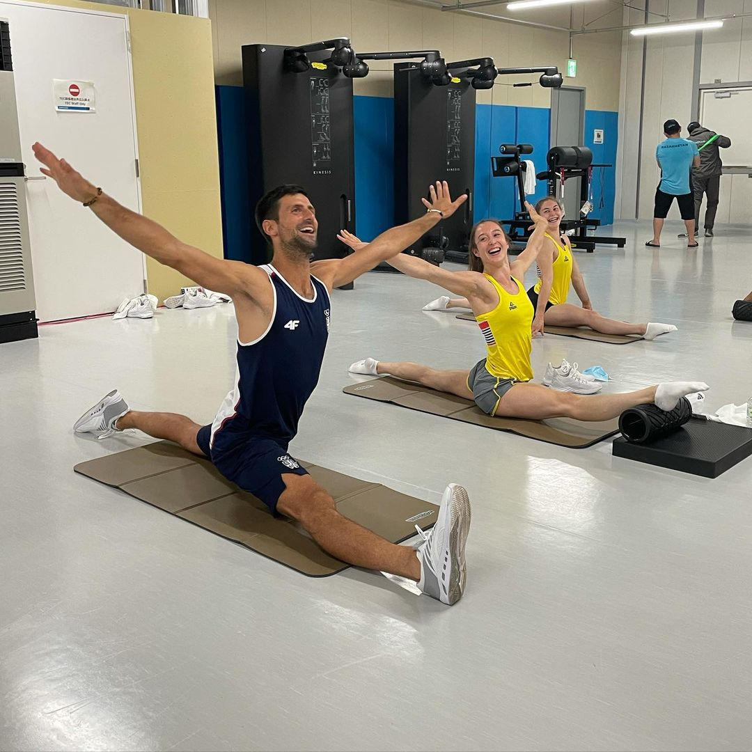 The Serbian tennis superstar posed in an eye-watering position with the Belgian gymnastics team.
